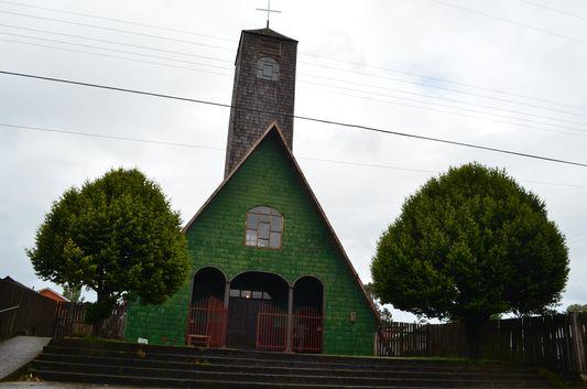 the green oldest church of Curaco de Velez on Quinchao island