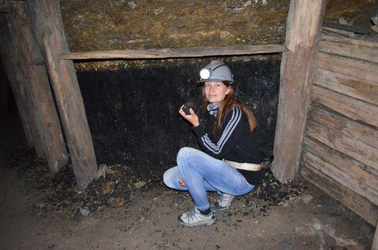 touching the charcoal in Chiflon del Diablo mine in Lota