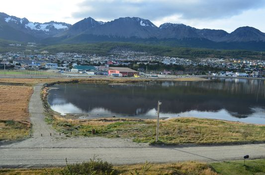 view of Ushuaia, its port and glacier Martial