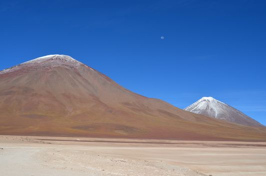 Licancabur volcano on the right with the Moon above it