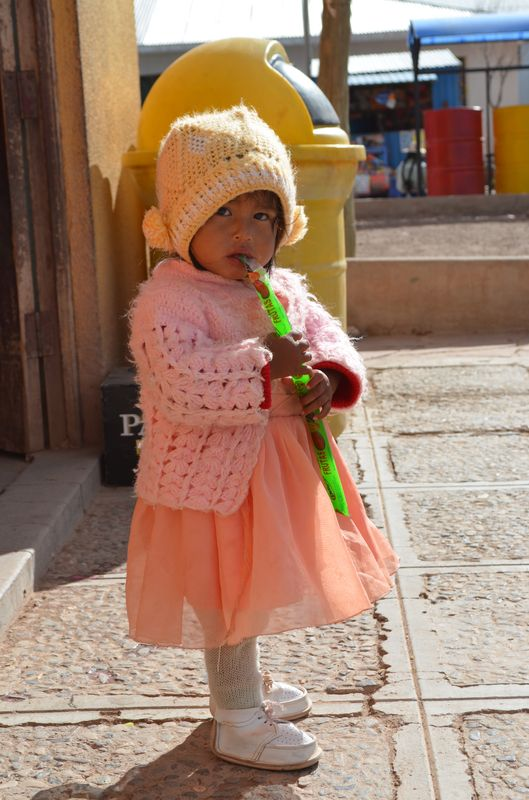 a cute Bolivian girl outside San Cristobal market