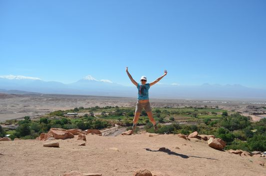 a jumping shot at Pukara de Quitor overviewing the Andes