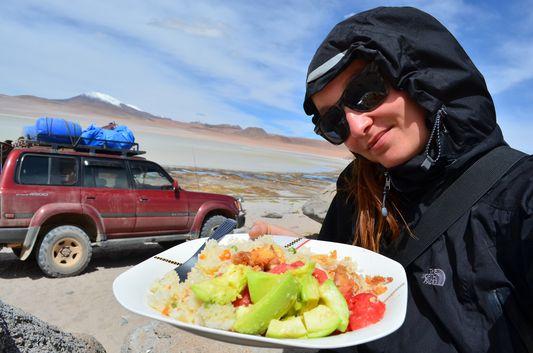 crazy sexy fun traveler eating lunch at Kqara lagoon