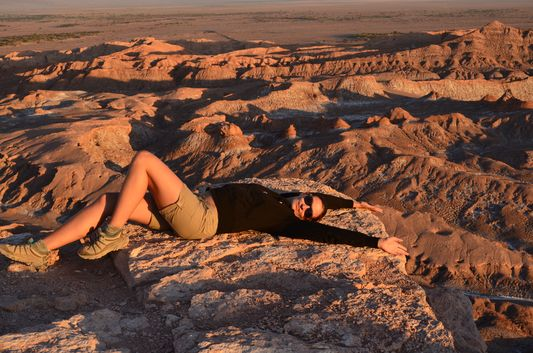 crazy sexy fun traveler relaxing on the rock of the Amphitheatre
