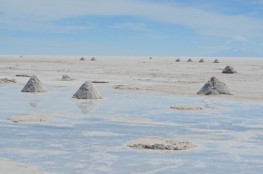 salt pyramids surrounded with rain water