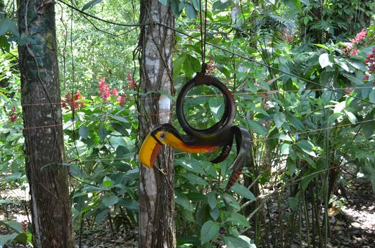 a toucan decoration made of tyre
