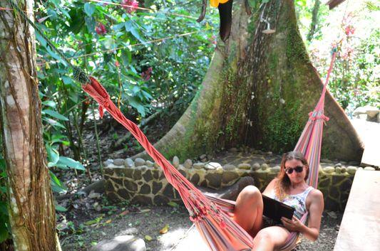 crazy sexy fun traveler relaxing in the hammock