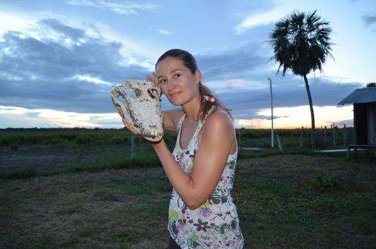 crazy sexy fun traveler with a caiman skull