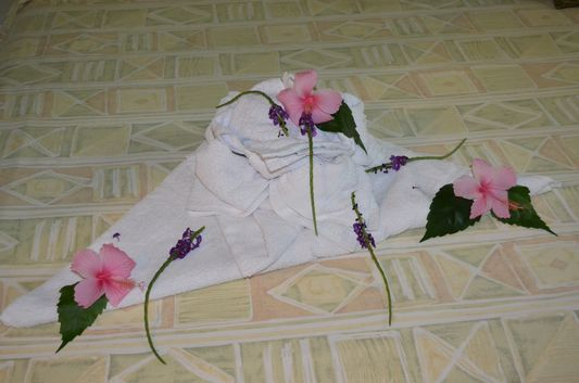 towel and flower decorations on my bed