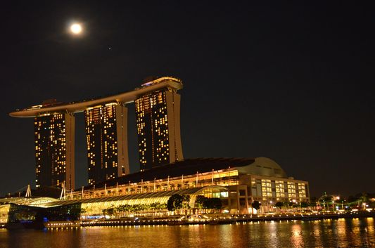 full moon above Marina Bay Sands Hotel