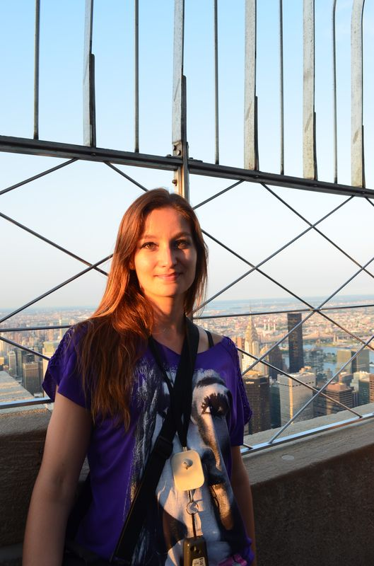 crazy sexy fun traveler on top of the 86th floor of the Empire State Building
