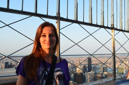 crazy sexy fun traveler on top of the Empire State Building