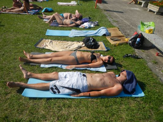 sunbathing at the pool in Humenne with Matt