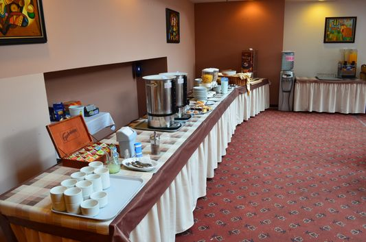 drinks, bread and cakes for breakfast in Golden Park Hotel