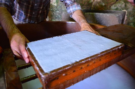 making a sheet of paper in the Paper Museum Terras de Santa Maria