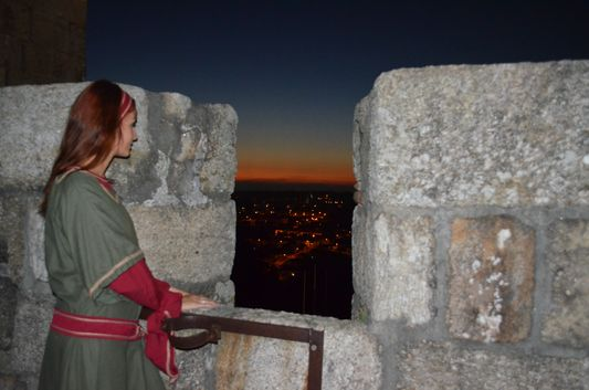 pretending to be a medieval princess enjoying the sunset