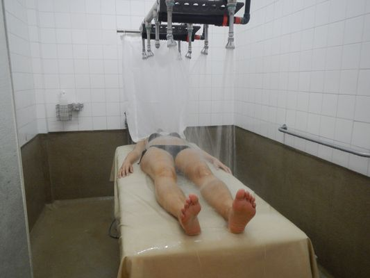 crazy sexy fun traveler getting shower massage in Balneari Prats