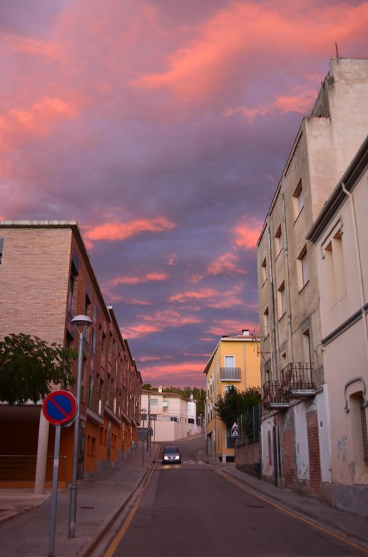 sunset above little streets of Caldes de Malavella