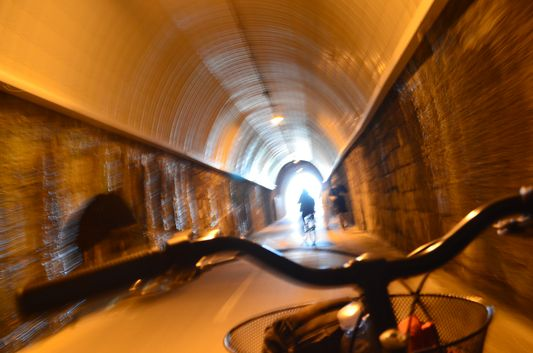 cycling through a tunnel of the old railway line