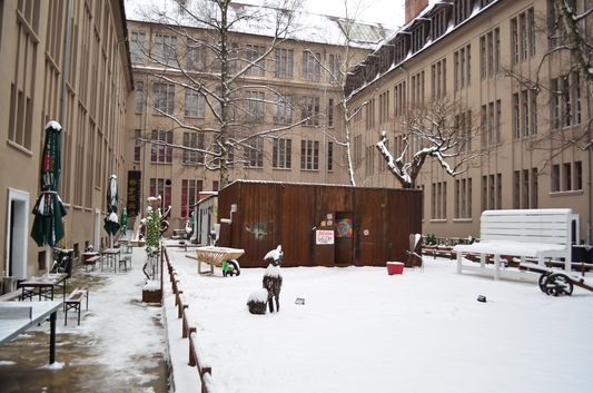 Plus Berlin hostel courtyard with the artists' studio and sculptures