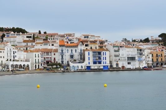 the reddish roofs of white Cadaques buildings