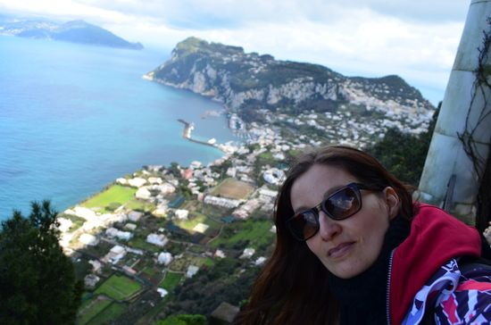 crazy sexy fun traveler with the view of Marina Grande on Capri island