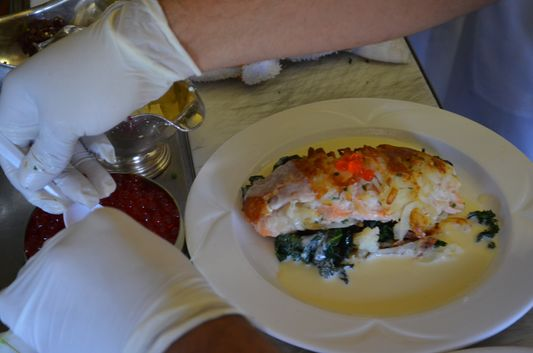 preparing salmon hash brown on Napa Valley Wine Train