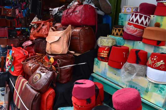traditional hats and leather bags sold in Medina
