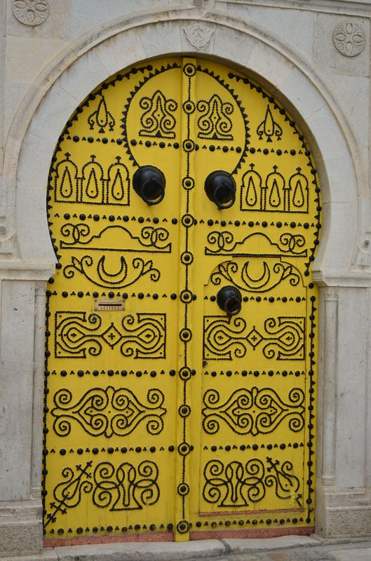 typical massive yellow doors in Medina