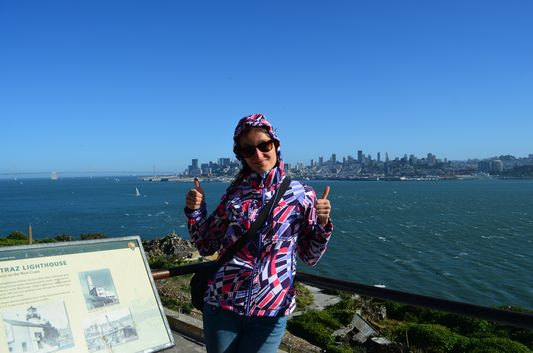 Crazy sexy fun traveler on Alcatraz island overlooking San Francisco