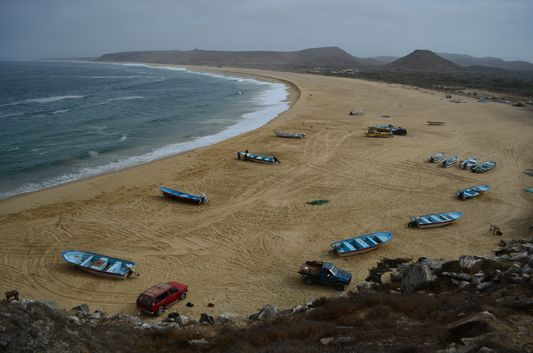 Punta Lobos sand beach with fishing boats