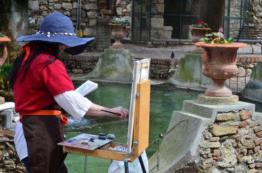 a painter in Trevelyan's gardens in Taormina