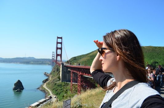 crazy sexy fun traveler at Golden Gate Bridge