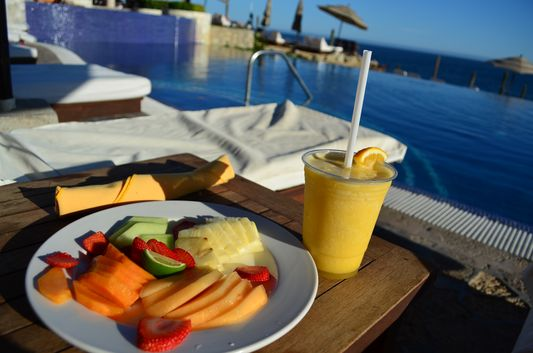 fruit and smoothie by the pool