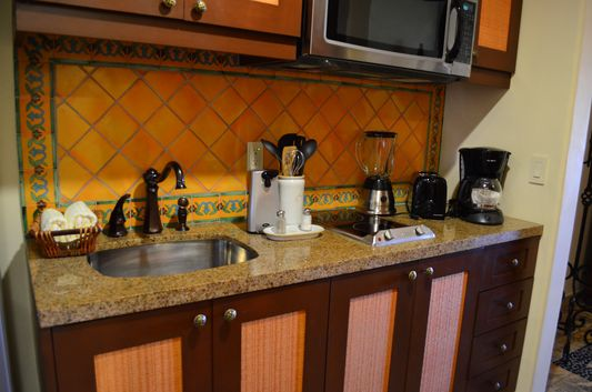 fully-equipped kitchen in Hacienda Encantada room