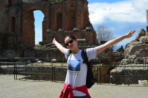 happy in the Greco-Roman amphitheatre in Taormina