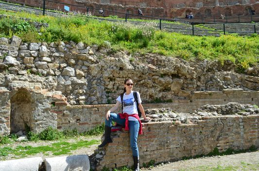 relaxing at the Greco-Roman amphitheatre in Taormina