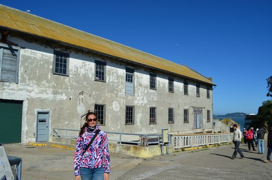 walking around Alcatraz island with Quartermaster warehouse behind me
