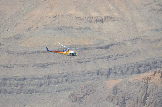 watching helicopters flying over Grand Canyon West Rim