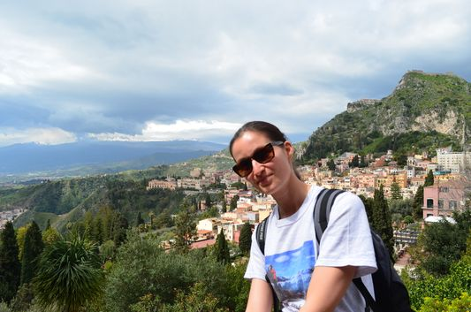 with snowy volcano Etna covered with clouds behind me