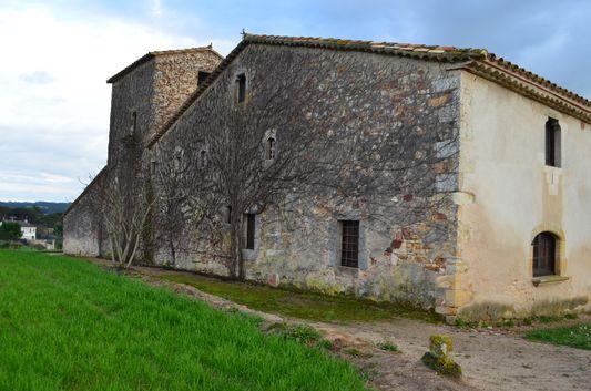 overgrown building next to San Sebastian church