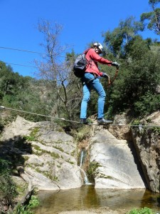 crossing the river of via ferrata