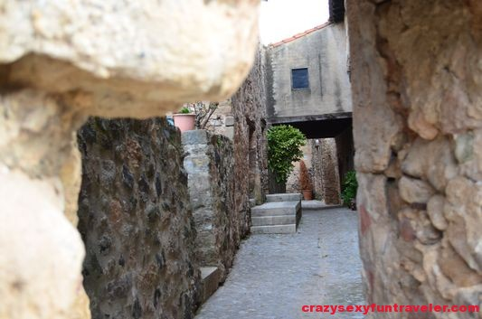 strolling along narrow medieval streets in Santa Pau
