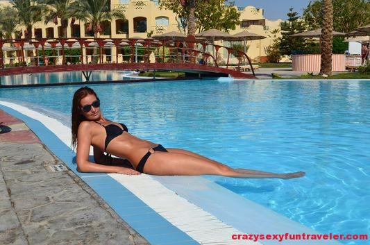 Crazy sexy fun traveler sunbathing in Egypt