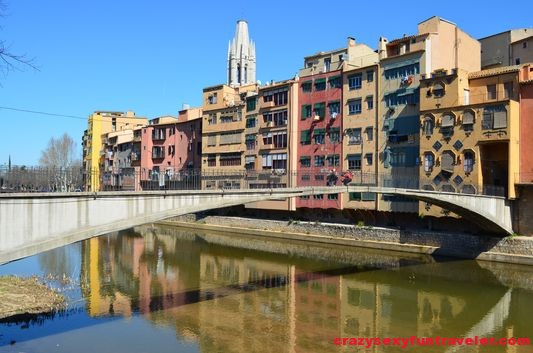 Girona painted houses with one of the many bridges