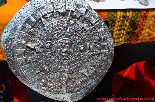 a silver Aztec calendar