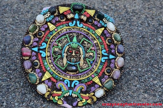 a very colourful Piedra del sol Aztec calendar