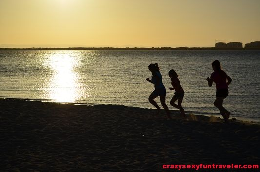 children running along the La Paz coast