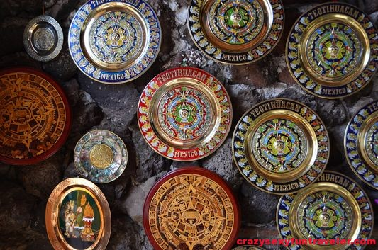 colourful Aztec calendar plates in the stores