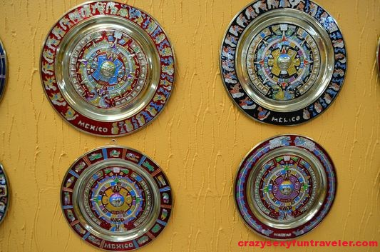 different metal Aztec calendars to hang on the wall